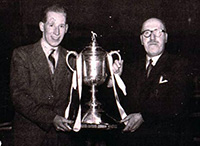 Billy and Willie Dunn hold the Scottish Cup trophy