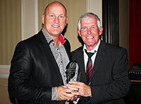 George is presented with his Hall of Fame memento by Jim Duffy in 2011