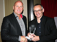 Pat receives a souvenir to mark his induction to the Hall of Fame in 2011