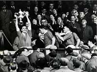 Harry Haddock holds the Scottish Cup aloft after the 1958 victory